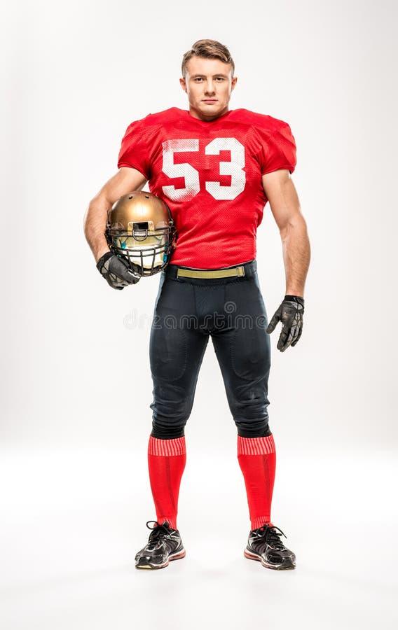 Football player holding helmet royalty free stock image