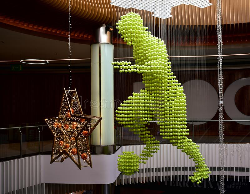 Football player made with tennis balls and Christmas decorations in a mall. La Coruna, Spain. Football player made with tennis balls. Christmas decorations in a stock photo
