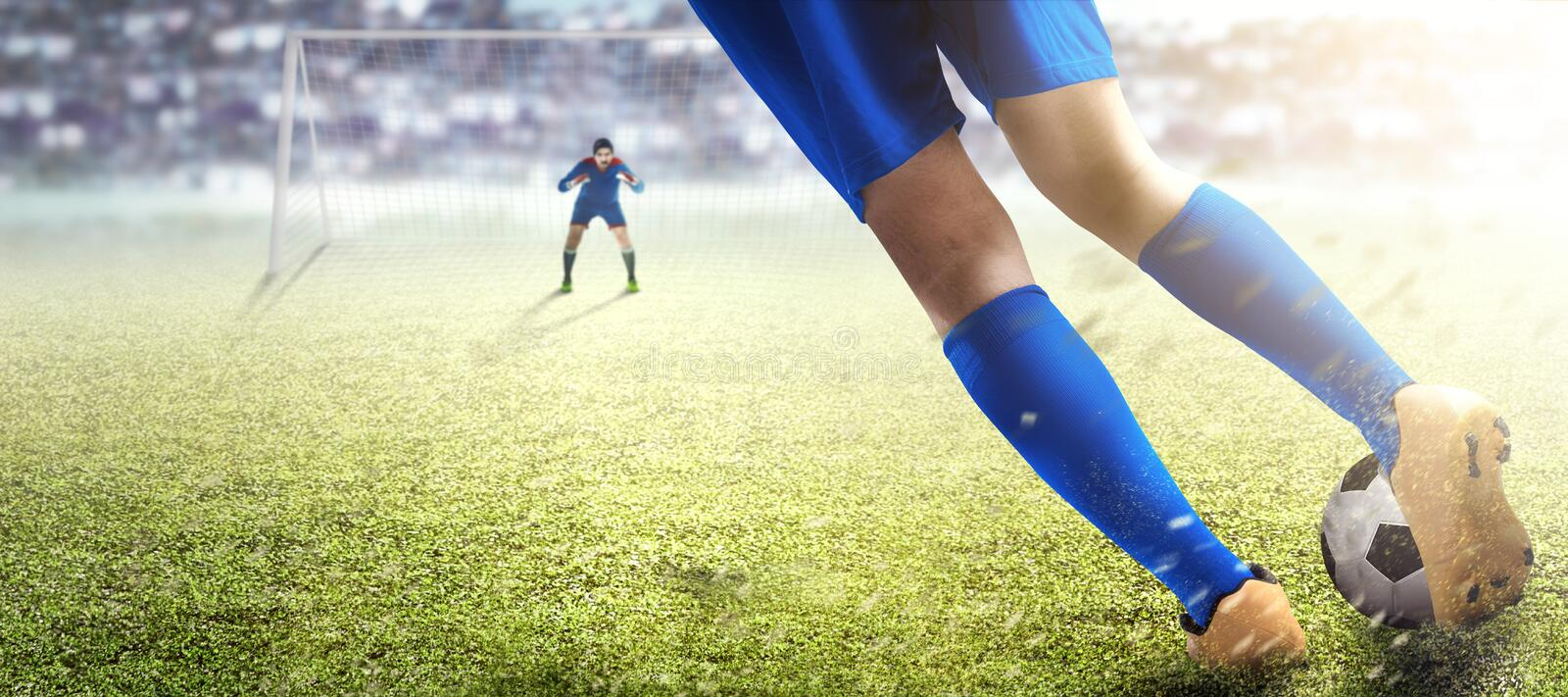 Football player man kicking the ball in the penalty box. On football field at stadium royalty free stock image