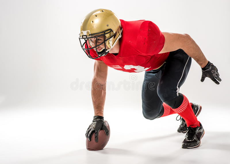 Football player in protective sportswear stock image