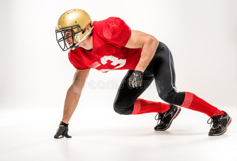 Football player in protective sportswear stock photo