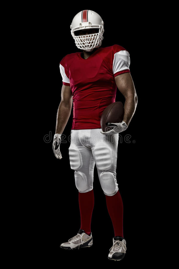 Football Player. With a red uniform on a black background royalty free stock photography