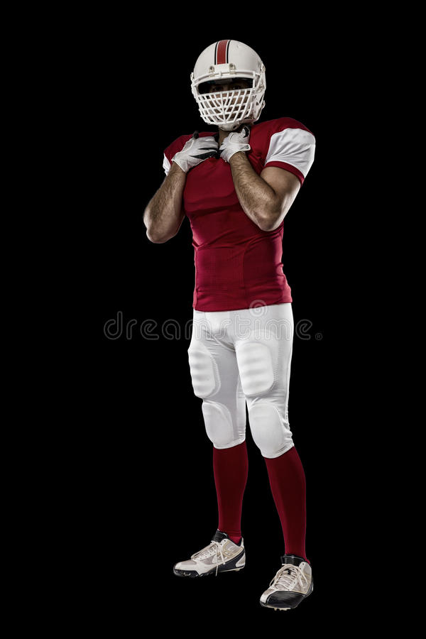 Football Player. With a red uniform on a black background royalty free stock images
