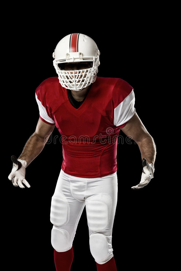 Football Player. With a red uniform on a black background stock photo