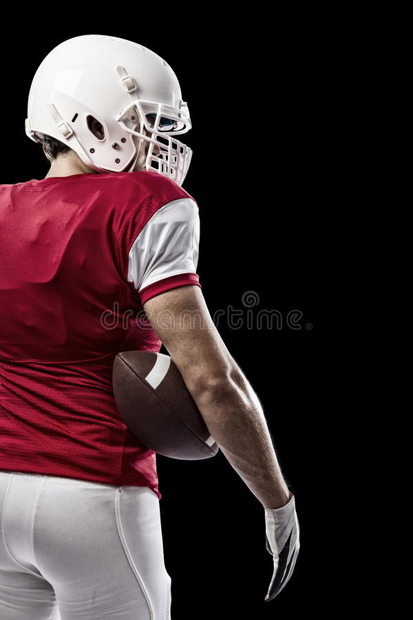 Football Player. With a red uniform on a Black background stock photography