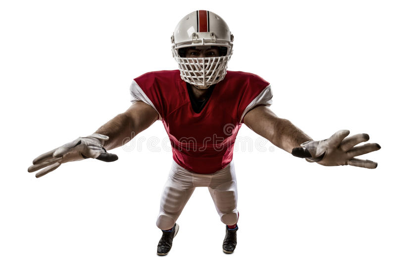 Football Player. With a red uniform making a tackle on a white background stock photography