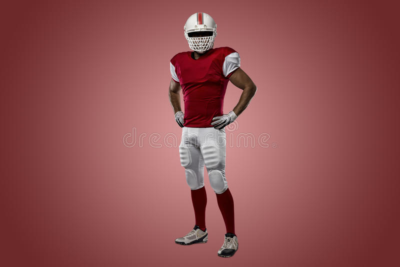 Football Player. With a red uniform on a Red background royalty free stock photography