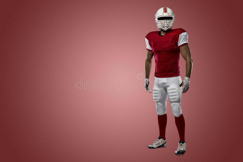 Football Player. With a red uniform on a Red background stock images