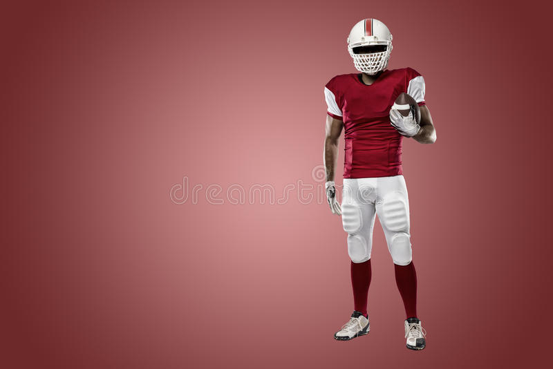 Football Player. With a red uniform on a Red background royalty free stock photos