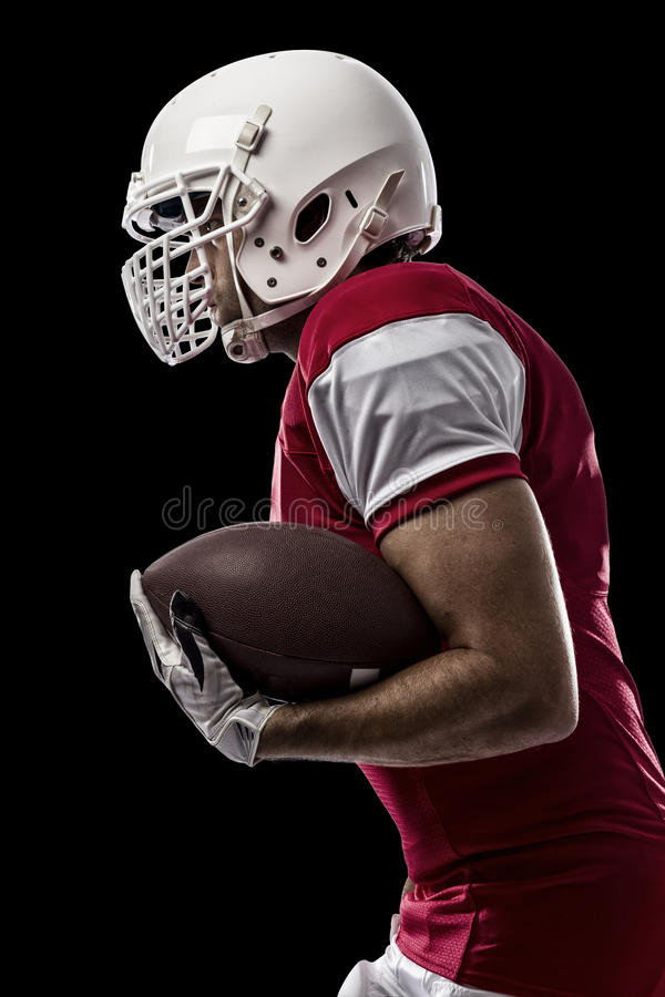 Football Player. With a red uniform Running on a Black background stock image
