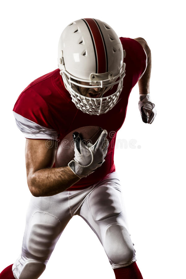 Football Player. With a red uniform Running on a white background royalty free stock photography