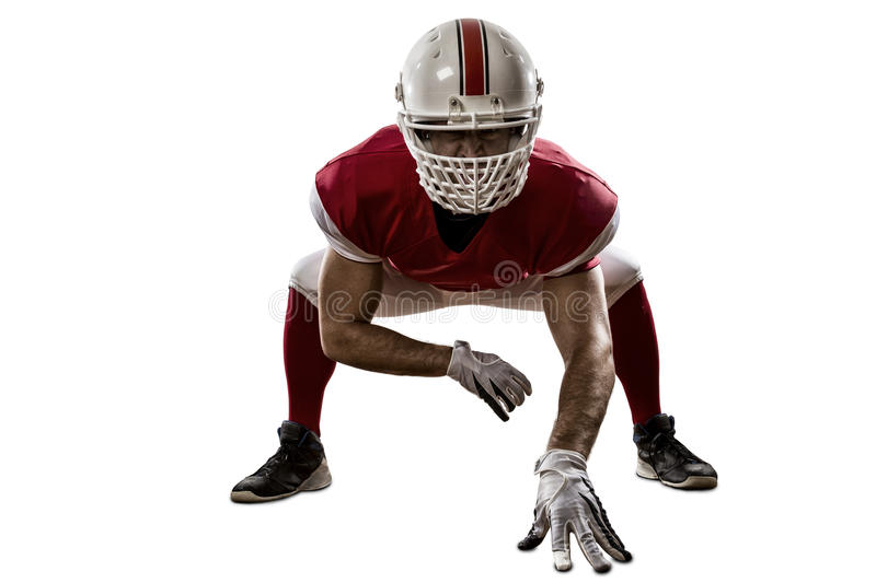 Football Player. With a red uniform on the scrimmage line, on a white background stock photo