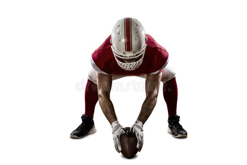 Football Player. With a red uniform on the scrimmage line, on a white background stock photos