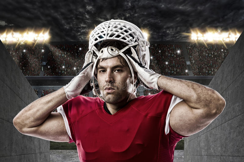 Football Player. With a red uniform on a stadium tunnel stock photo