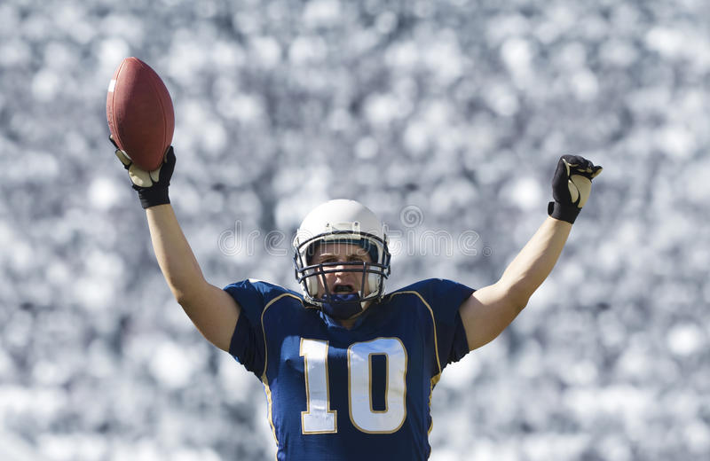 Football Player Scoring a Touchdown royalty free stock photography