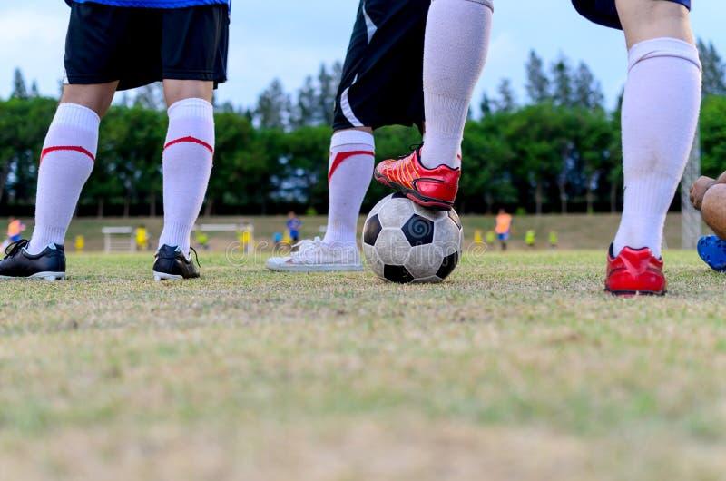 Football Player  Step On Football Stock Image