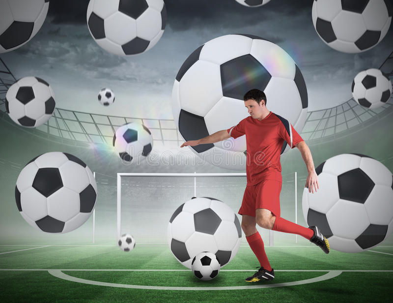 Football player about to take a penalty. Composite image of football player about to take a penalty against football pitch in large stadium royalty free stock photos