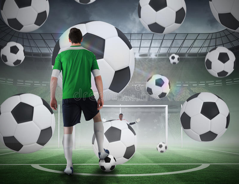 Football player about to take a penalty. Composite image of football player about to take a penalty against football pitch in large stadium stock images