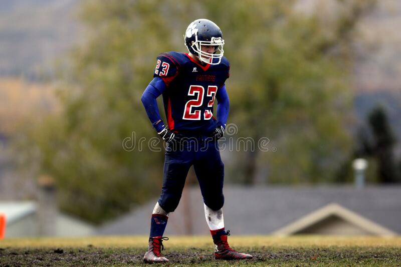 Football Player Wearing No. 23 Jersey Standing On Field Free Public Domain Cc0 Image