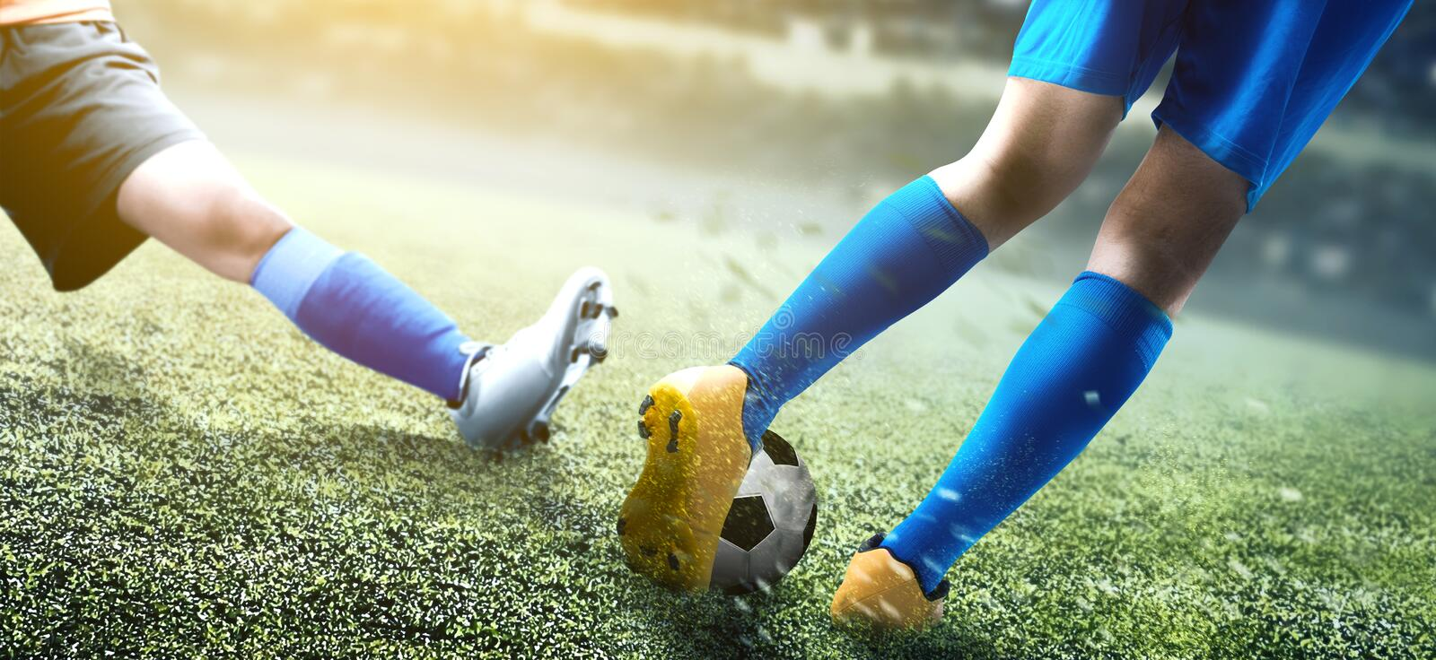 Football player woman sliding tackle the ball from his opponent. On football field at stadium royalty free stock photos