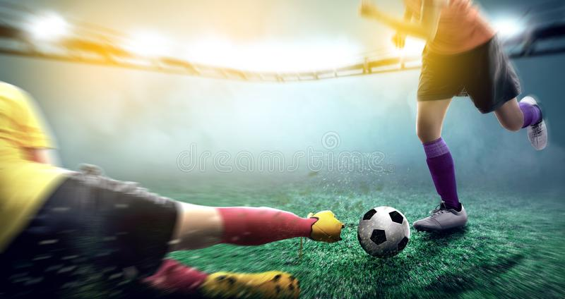 Football player woman in yellow jersey sliding tackle the ball from his opponent. On football field at stadium stock photo