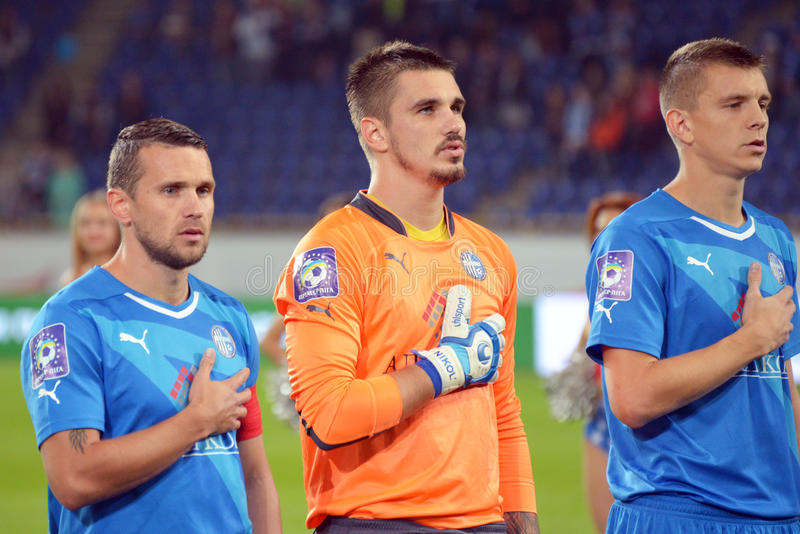 Football players are listening a national anthem photo was taken during the match between fc dnipro dnipropetrovsk city and fc stock image