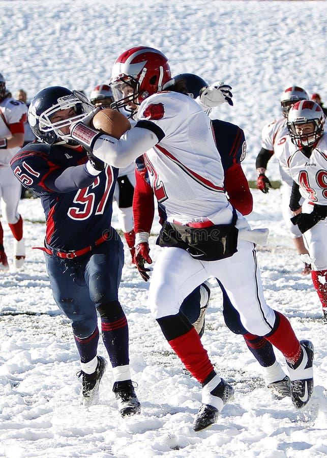 Football players on snowy field