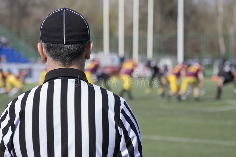 Football referee. Observing the match stock images
