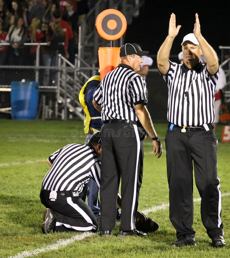 Free Football Referees Gesturing Fourth Down And Short Royalty Free Stock Images - 34890949