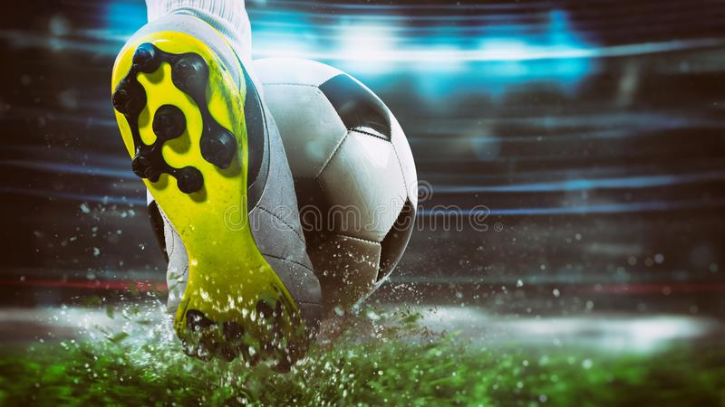 Football scene at night match with close up of a soccer shoe hitting the ball with power royalty free stock image