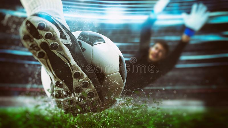 Football scene at night match with close up of a soccer shoe hitting the ball with power. Soccer player kicks the ball vigorously at the stadium stock photo