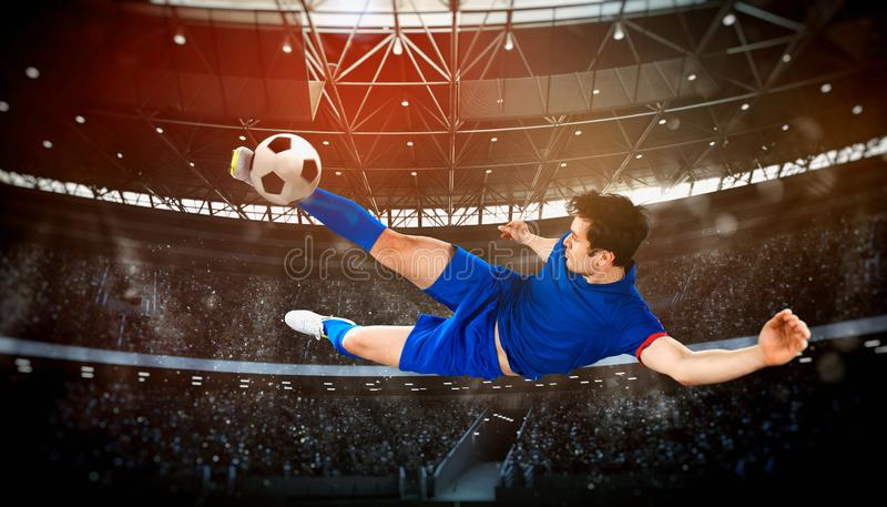 Football scene at night match with player kicking the ball with power royalty free stock images