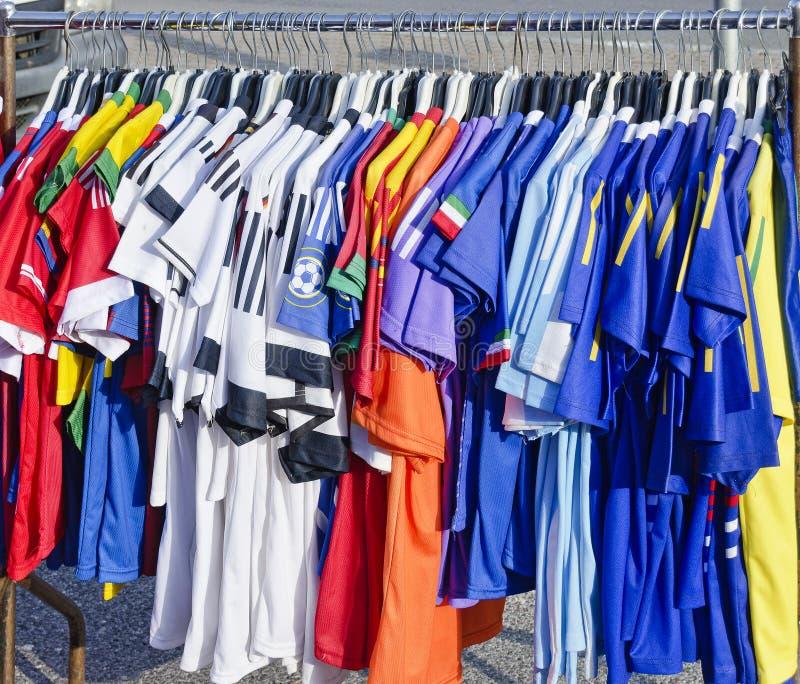 Football shirts on a hanging rail royalty free stock photo