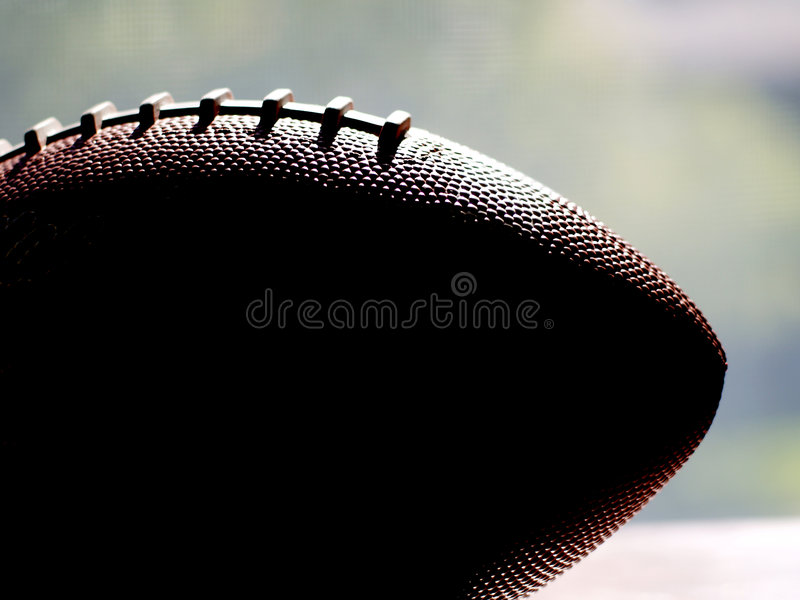 Football in silhouette against window royalty free stock images