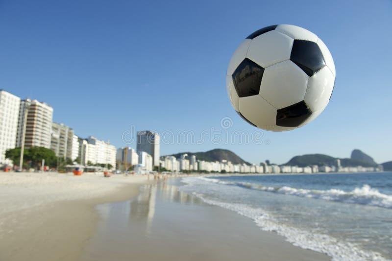 Football Soccer Ball Above Copacabana Beach Rio Brazil. Football soccer ball in the sky above Copacabana Beach Rio de Janeiro Brazil stock image