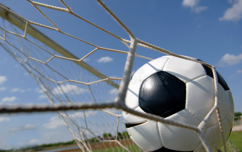 Football - Soccer ball in Goal stock photo