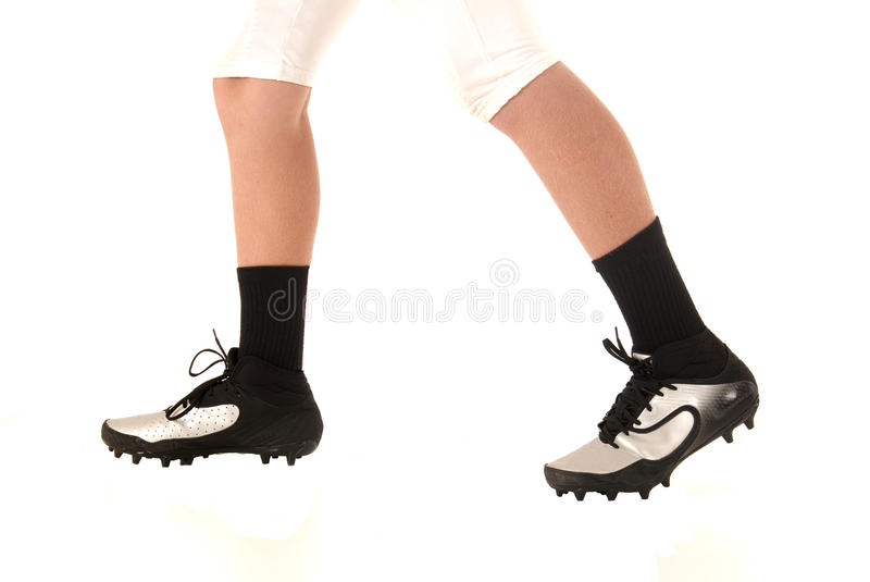 Football or soccer cleats closeup with a white background. Soccer football cleats shoes closeup white background royalty free stock photography