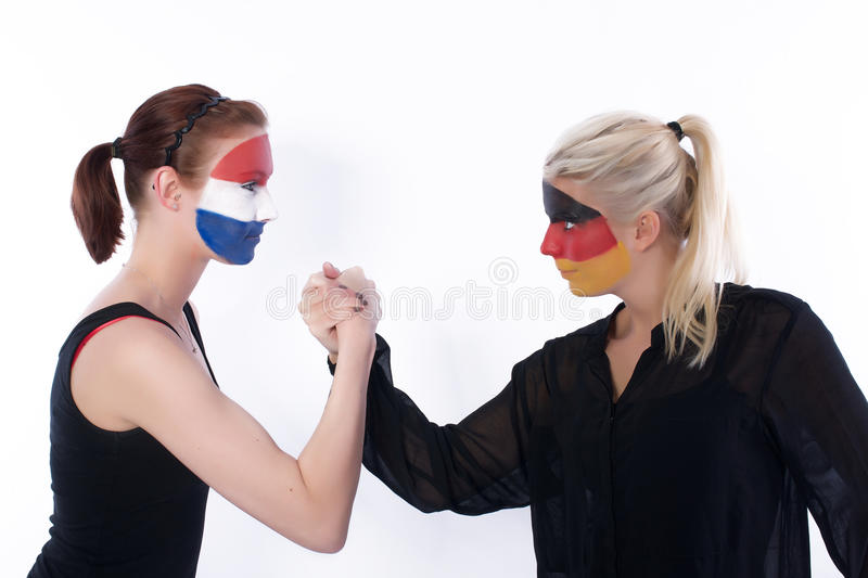 Football soccer fans arm wrestling. Picture of football soccer fans arm wrestling stock image