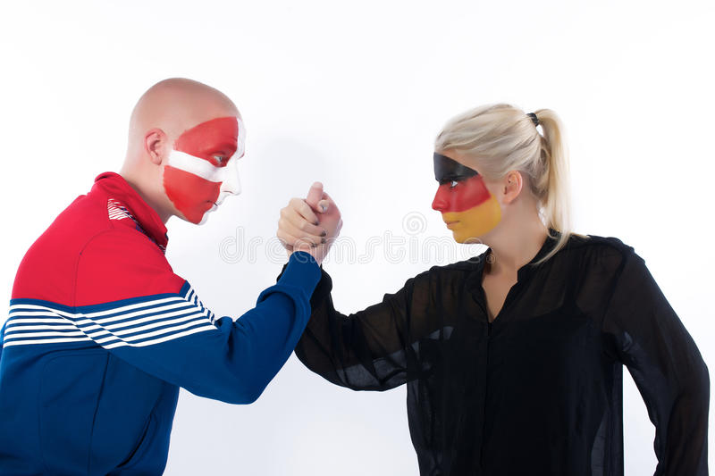 Football soccer fans arm wrestling royalty free stock image