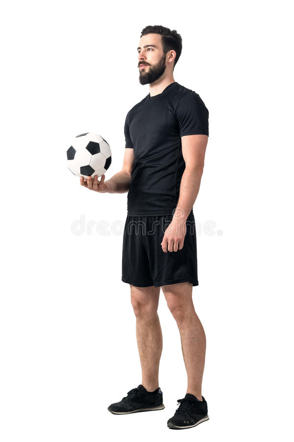Football or soccer futsal player holding ball in one hand looking up royalty free stock photo