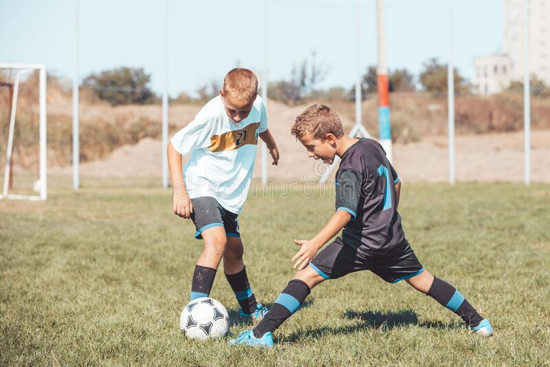 Football soccer game on the sports field royalty free stock images
