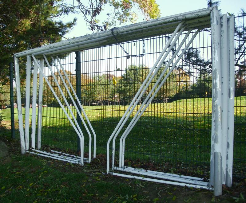 Football Soccer Goalposts, Chained to a Fence in a Public Park stock photos
