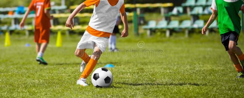Football Soccer Match for Children. Kids Soccer Teams Playing Training Match. Football Soccer Match for Children. Kids Soccer Teams Playing Training Game on stock photo
