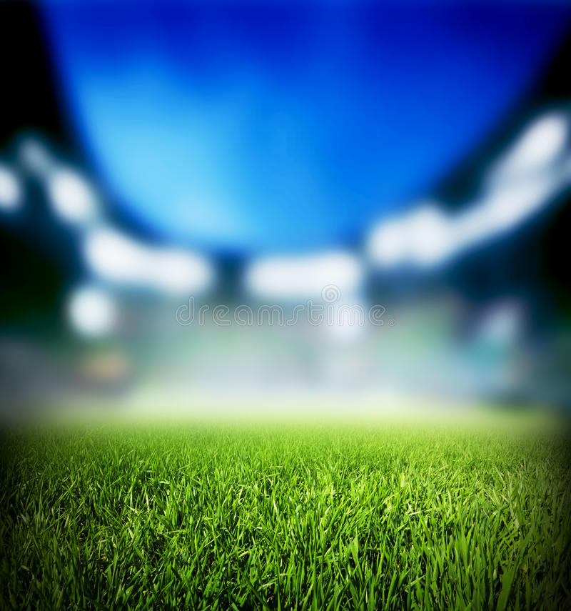 Football Stadium Night Lights: Football, Soccer Match. Grass Close Up On The Stadium