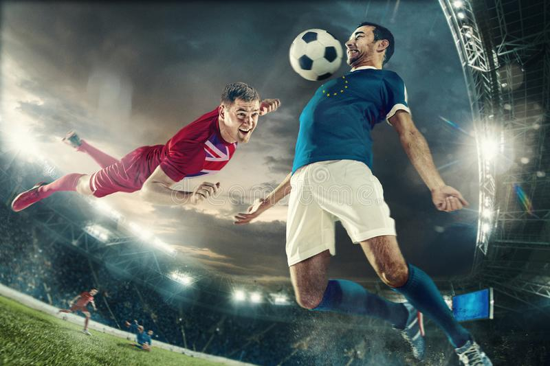 Football or soccer players colored in United Kingdom and European Unity flags. Brutal game for power. Football or soccer players colored in United Kingdom and stock photos