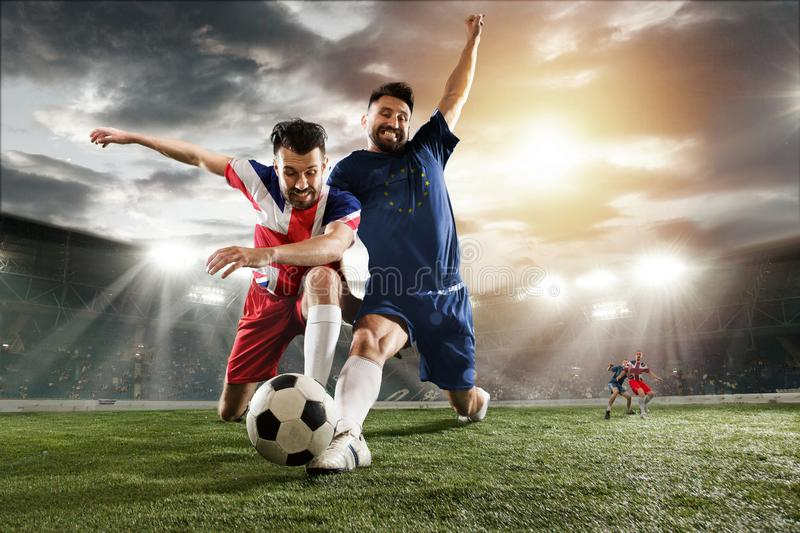 Football or soccer players colored in United Kingdom and European Unity flags royalty free stock photography