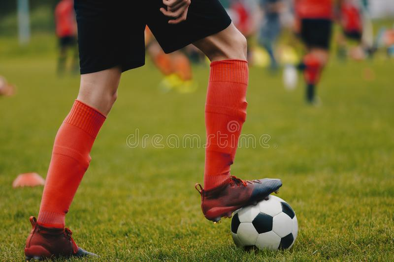 Football Soccer Practice Session. Young Soccer Player in Training with Ball. Soccer Practice Session royalty free stock images