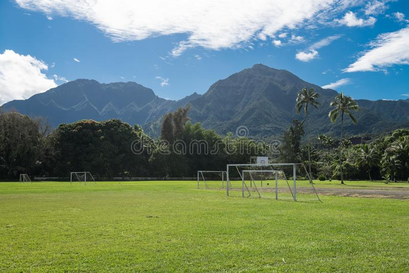Football soccer school training field playground on tropical island near mountains. Football soccer school training field playground on tropical island near royalty free stock photo