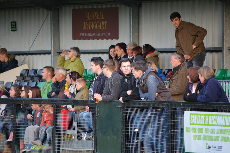 Football Spectators in the Stand. AFC Haywards Vs Cuckfield cup final football match, `Tester Challenge Cup` at Burgess Hill Stadium, UK, 28th April 2015 royalty free stock photo