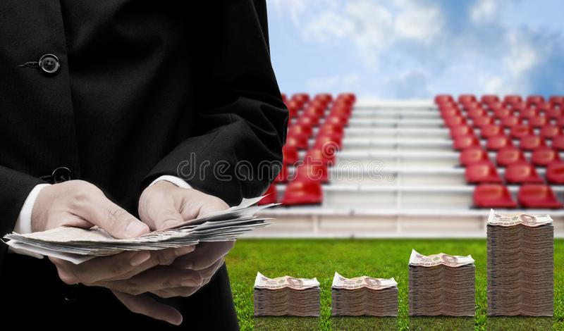 Football sport business, Money profit in hand royalty free stock photography